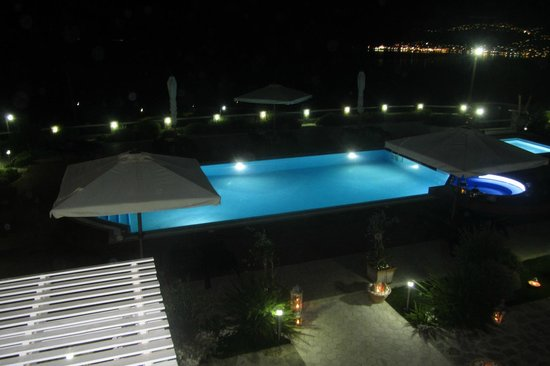 Miland Suites: View of pool from Room 9 at night