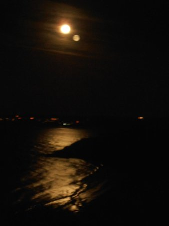 Carlyon Guest House: View over the sea at night from room window