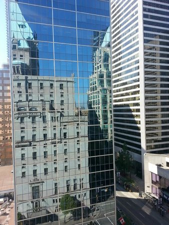 Fairmont Hotel Vancouver: The Fairmont reflected on the glass building across the street