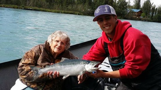 Chugach Backcountry Fishing - Day Trips: My 88 year old mother with her first line-caught Sockeye Salmon.  Guide Jerod was so proud of he