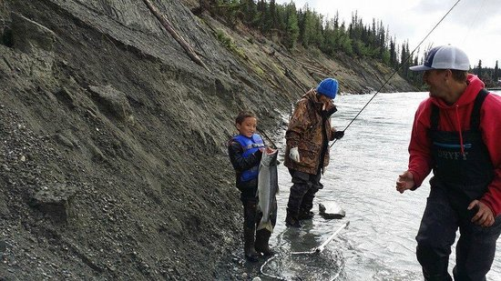Chugach Backcountry Fishing - Day Trips: My 7 year old grandson with his first line-caught Sockeye Salmon.