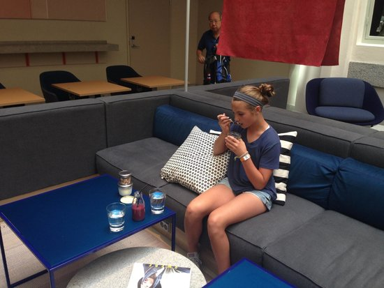 Scandic No. 53: Indoor loungy area and daughter eating breakfast