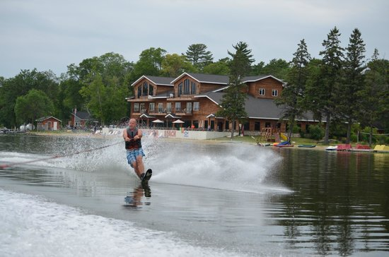 Hiawatha Beach Resort : Old guy waterskiing, main resort, beach area in background