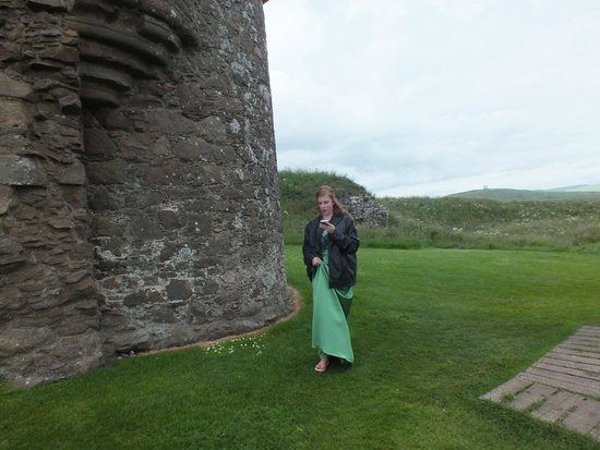 Dunnottar Castle: Our oldest daughter strolling the grounds of the castle.