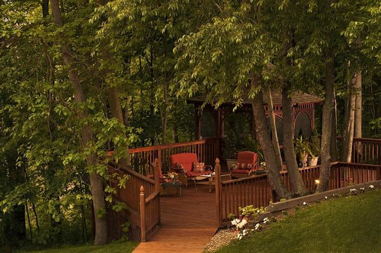 Castle in the Country Bed & Breakfast Inn : Relax under the trees at the Castle's Gazebo decks