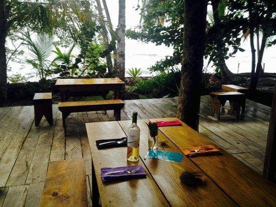 The Firefly Restaurant & Bar: Table set for dinner overlooking ocean