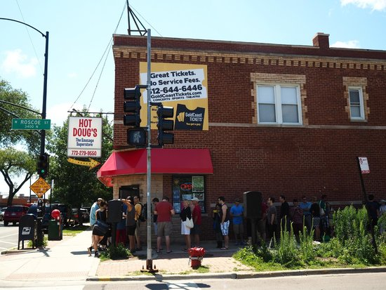 Hot Doug's Inc. : The line at Hot Doug's at the corner of North California and West Roscoe