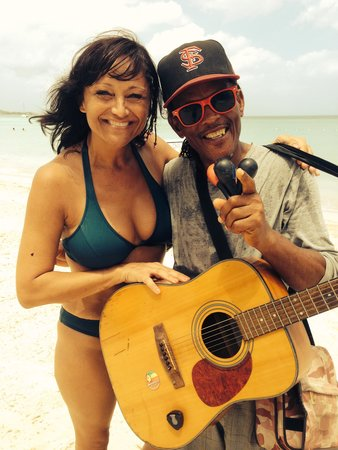 Idle Awhile The Beach: Me and Howie , the strolling musician