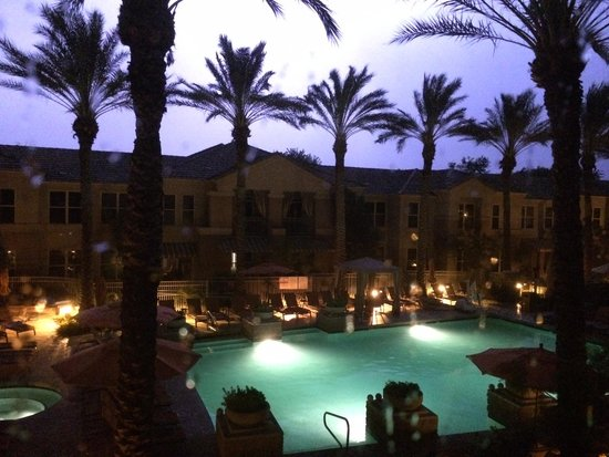 Gainey Suites Hotel: Pool lit up by lightning at night