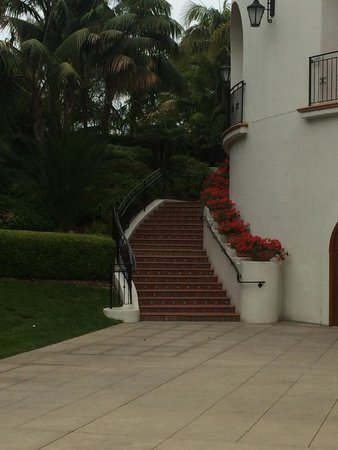 The Ritz-Carlton Bacara, Santa Barbara: Stair case from main floor up to reception area, loved the flowers