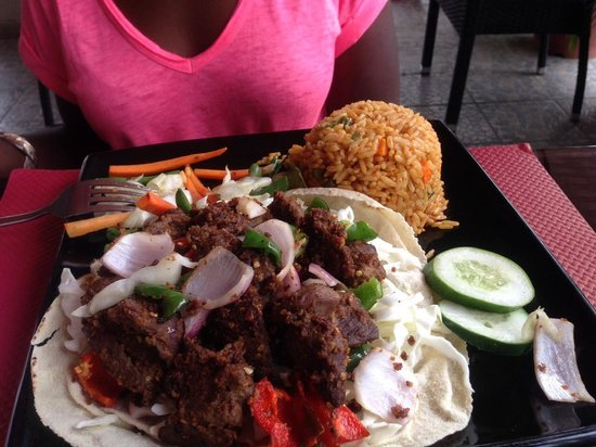 The Charcoal Grill Restaurant & Coffee Lounge: Nigerian beef suya and spicy rice