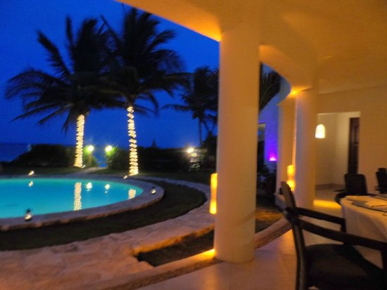Pavo Real by the Sea: view from the patio after dark