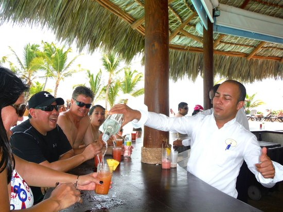 Sanctuary Cap Cana by AlSol: our man Carlos serving it up at the swim-up pool bar
