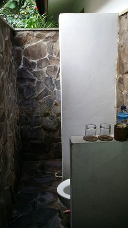 The Beach House Resort: Bathroom. Small, no roof. Can get mosquitoes & ground get dirty very quickly. But fairly clean.