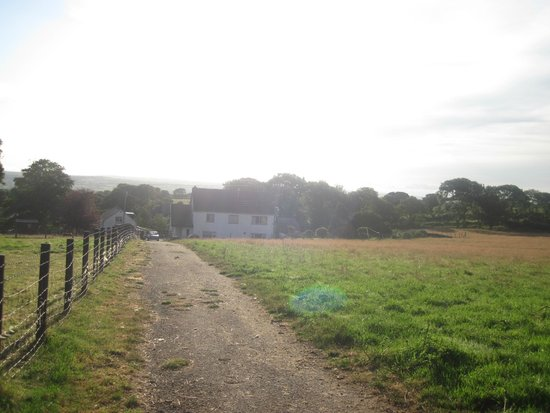 Trenewydd Farm Cottages: View of farmhouse from top field