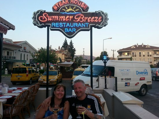 My wife and I enjoying an evening meal at Summer Breeze