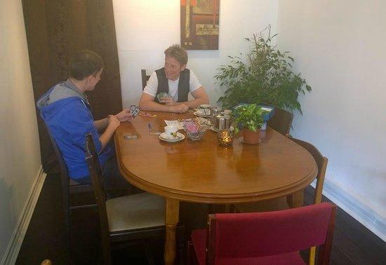Just Vintage Tea Room Cafe: Customers enjoying a board game and tea