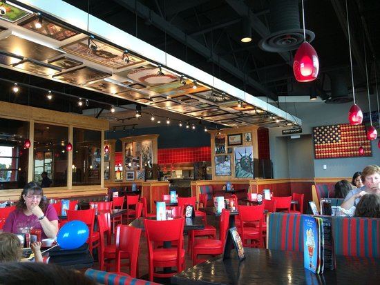 Red Robin inside the Red Mill Commons shopping center is a great spot for visitors to rest their feet while digging into an affordable and satisfying meal. The chain restaurant is famous for its burgers and fries, as well as thick and satisfying milkshakes. This location of Red Robin is never closed, as it is open 24 hours a day, seven days a mobzik.tke: American.