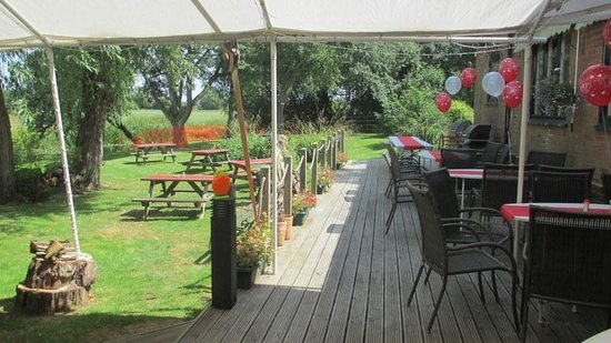 The Gate Hangs Well: View of the garden from the marquee