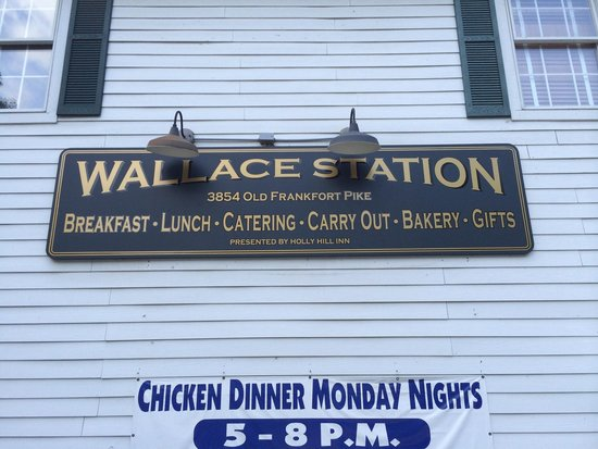 Wallace Station: Sign on side of building.