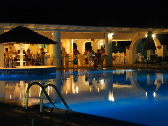 Mediterranean Beach Resort : The pool and bar area at night
