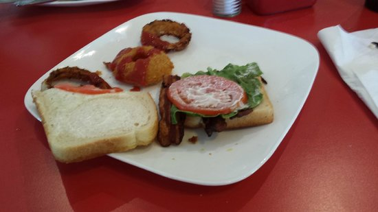 Elvira's Cafe: One thin piece of lettuce,  one thin cut tomato and 3 strips of bacon for 10 bucks,  I dont thin