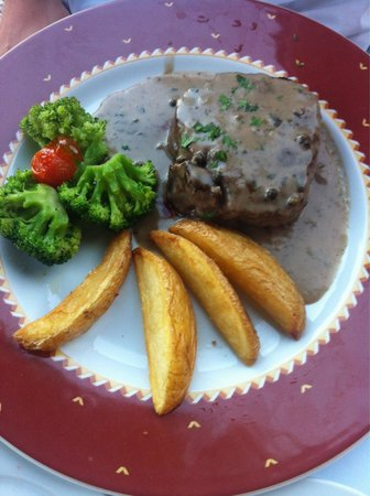 Tournedos of beef with pepper sauce.