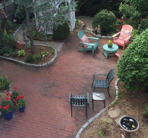 Secret Garden Inn : The Secret Garden's serene garden, with gazebo and fountain, seen from the deck.