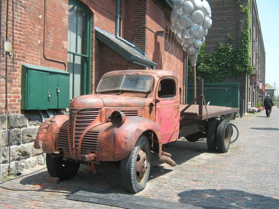 Distillery Historic District: Old truck beside one of the historical buildings