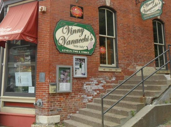 Vinny Vanucchi's: They have their menu posted on the side of the building.  They're not located downstairs.  You h