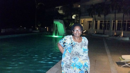 Couples Tower Isle: poolside at night
