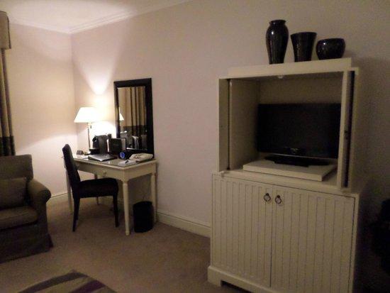 Macdonald Randolph Hotel: A safe and tea service are below TV behind the doors.