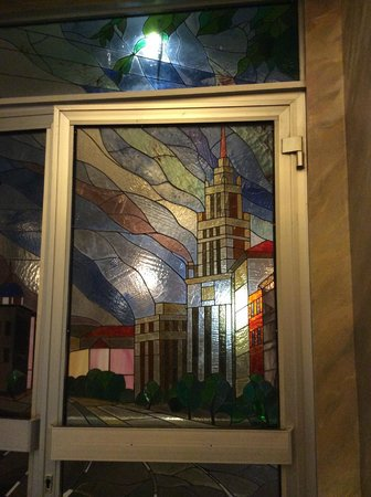 Budapest Hotel : Stained glass door, 2nd floor on way into dining room, showing one of Stalin's Seven Sisters