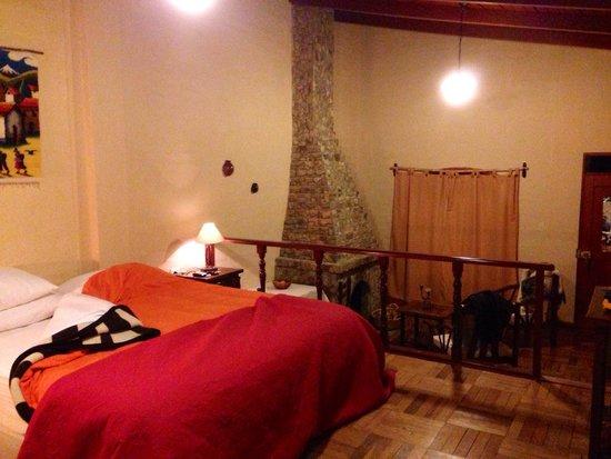Tuki Llajta Pueblo Bonito Lodge: Habitación con chimenea