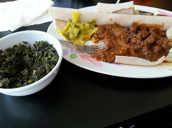 Altu's Ethiopian Cuisine : Lamb and Lentil combo on top of sponge bread.  Homestyle collard greens on the side.