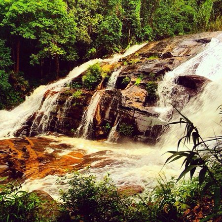 Untouched Thailand : Trekking past a waterfall on the way to a hill tribe