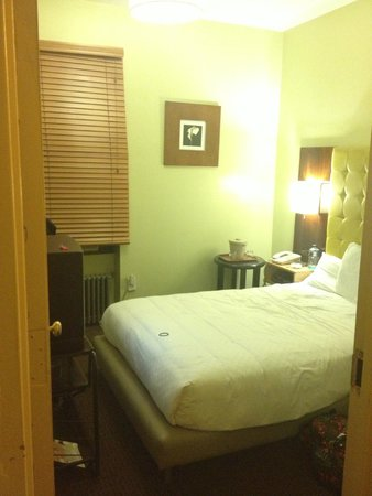 "Astor on the Park: Room 211- tiny shoebox room with a double bed we were told was a ""queen"""