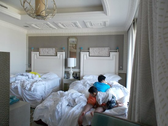 Waldorf Astoria Ras Al Khaimah: Two queen-sized beds with an extra bed