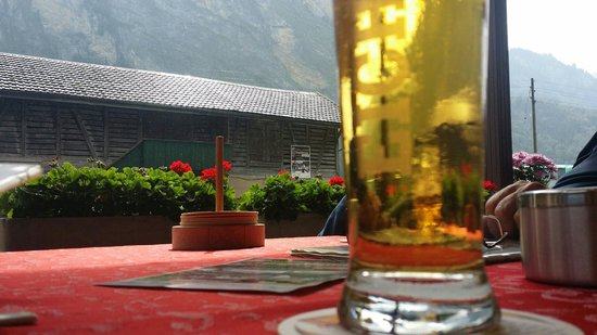 Hotel-Restaurant Alpina : A nice beer on patio