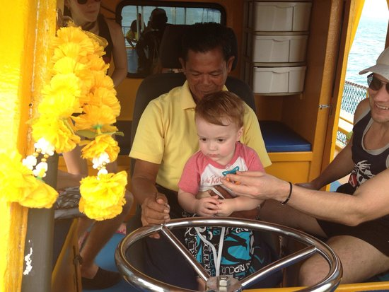 Two Sea Tour: My toddler helping the captain out