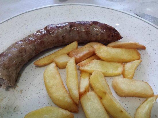 Botifarra a la brasa con patatas - Restaurant Can Massonet (Pujals dels Pagesos-Girona)