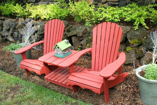 Lara House Bed and Breakfast: Adirondack chairs on side of house