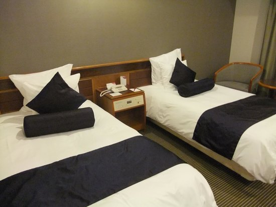 ANA Crowne Plaza Hiroshima: 綺麗なベッド周り