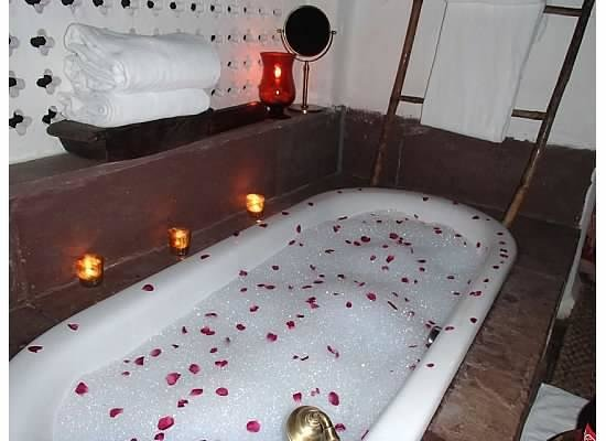 Mahua Kothi: The tub sprinkled with rose petals
