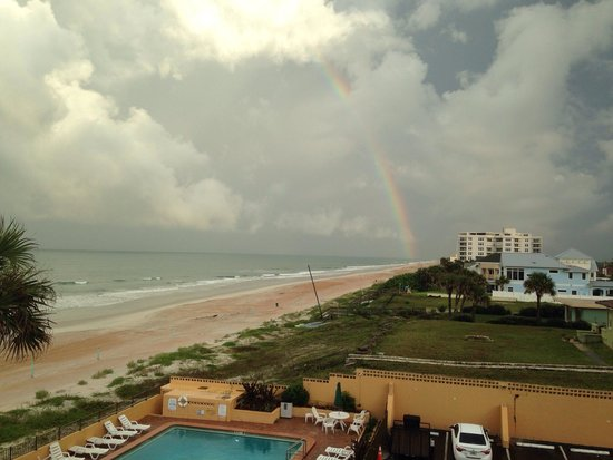 Quality Inn & Suites On The Beach: Beautiful picture of a rainbow on the beach. Picture was taken from our hotel room door.