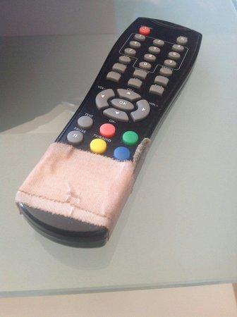 Salobre Golf Villas: Band aid on TV remote
