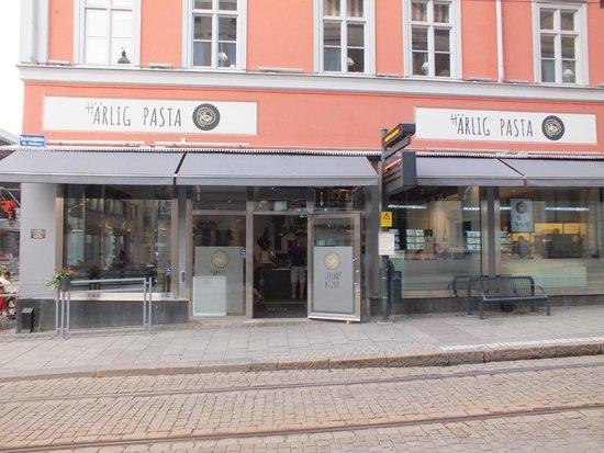 Harlig Pasta: Front entrance on Drottninggatan - tram runs by right in front