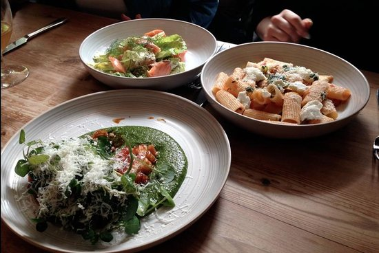 Jamie Oliver's Fifteen: one of each main course for lunch, salmon caesar salad, pork belly with polenta, rigatoni