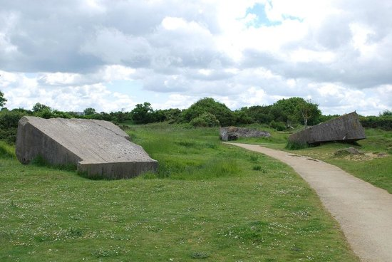 Pointe du Hoc : Craters and destroyed bunkers.
