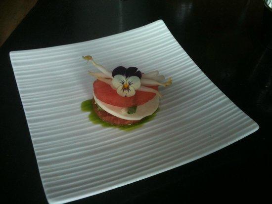 Les Deux Singes de Montarvie: amuse bouche with slice of watermelon